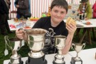Proudly showing off his four cups won in the domestic section at Gwinear show is Harry Vincent including best pa. | Gwinear Show